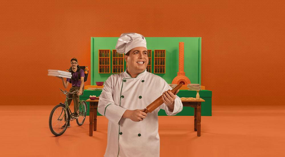 duas pessoas trabalhando em uma pizzaria e felizes por contar com plano de saúde empresarial Unimed Fortaleza